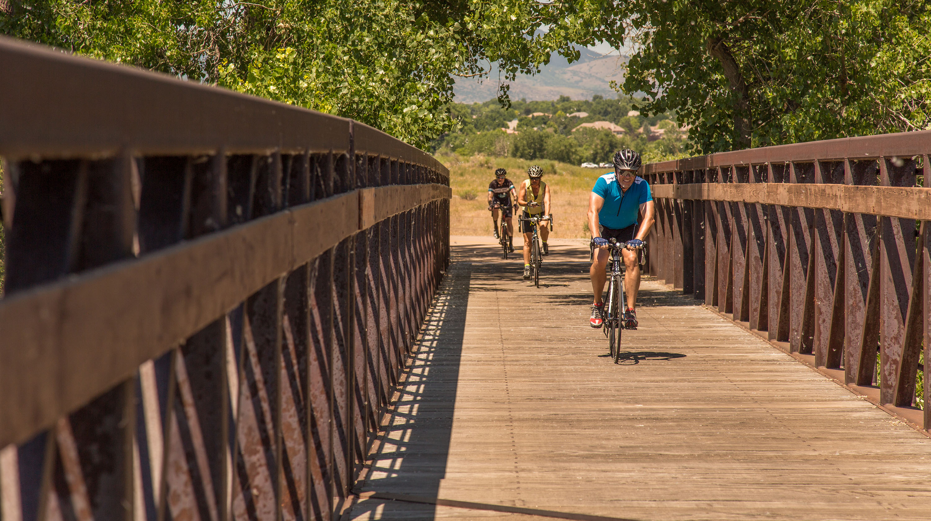 Cyclists Crossing Bridge